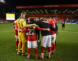 Charlton Athletic Manager Karl Robinson and his players in a huddle at full time