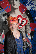 HATTIE STEWART; IN FRONT OF HER PAINTING, , Steve Lazarides and Pepsi host a collaboration of Street Art, Photography and Football. Photos of footballers by Danny Clinch, paintings by 6 'leading street artists' Victoria House, Southampton Row. London. 17 February 2014.