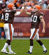 MORNING JOURNAL/DAVID RICHARD.Cleveland punter Kyle Richardson gets a high-five from quarterback Trent Dilfer after Richardson's first punt of the day went 49 yards backing the Titans up to their own 5 yardline.