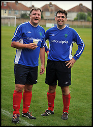 Shadow Chancellor Ed Balls with Shadow Secretary of State for Health Andy Burnham after playing in the Labour Politicians v Reporter's Football match at the Labour Party Autumn Conference. Sunday, 22nd September 2013. Picture by Andrew Parsons / i-Images