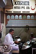 Mr Moin Uddin the chairman of Karim's serving food. Karim's Restaurant, Delhi, India