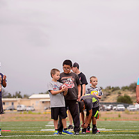 072915       Cable Hoover<br /> <br /> Camp participants line up to run drills during Miyamura football camp Wednesday at Miyamura High School.