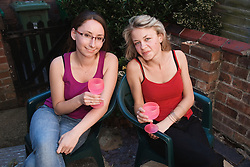 Two Polish friends having a drink outside,