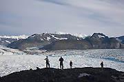 University of Colorado glaciologist Tad Pfeffer (r-l), photographer James Balog and Adam LeWinter, of the Extreme Ice Survey, and daughter Simone Balog stand around camp looking out over the terminus of the Columbia Glacier, near Valdez, Alaska.