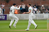 Wicket - Josh Davey of Somerset celebrates taking the wicket of Brett D'Oliveira of Worcestershire with Tom Abell of Somerset during the Specsavers County Champ Div 1 match between Somerset County Cricket Club and Worcestershire County Cricket Club at the Cooper Associates County Ground, Taunton, United Kingdom on 22 April 2018. Picture by Graham Hunt.