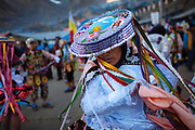 Dancer with traditional clothes and a hat hand embroidery during celebration of the Lord of Qoyllur Rit'i (The Lord of the Shining Snow) in Cusco, Peru.