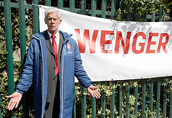 An Arsene Wenger lookalike poses for a picture before the Emirates FA Cup Final at Wembley Stadium, London.