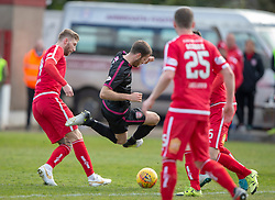 Arbroath's Danny Denholm tackled. Brechin City 1 v 1 Arbroath, Scottish Football League Division One played 13/4/2019 at Brechin City's home ground Glebe Park. Arbroath win promotion.