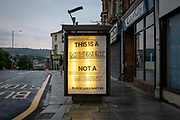 This is a Movement, NOT a Moment Black Lives Matter poster appeared in the advertising hoarding on the side of a bus stop on Shellons Street on the 14th of July, 2020 in Folkestone, United Kingdom. Black Lives Matter is an international human rights movement, originating in the African-American community, that campaigns against violence and systemic racism towards black people.