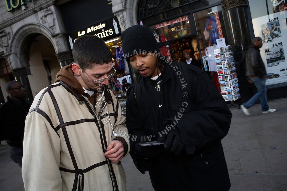 Iron Braydz, 26, is talking to a passer by about Blind Alphabetz's new album on Wednesday, Feb. 7, 2007, in London, England. Islamic Hip Hop artists like the duo 'Blind Alphabetz', from London, feel more than ever the need to say what they think aloud. In the music industry the backlash of a disputable Western foreign policy towards Islamic countries and its people is strong. The number of artists in the European Union and the US taking this into consideration and addressing the current social and political problems within their lyrics is growing rapidly and fostering awareness for Muslim and others alike.