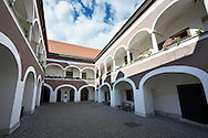 17th century Eszterhazy courtyard of the   Palace (Eszterhazyvak Palotája) -  Fo Square (F? Ter), Sopron, Hungary .<br /> <br /> Visit our HUNGARY HISTORIC PLACES PHOTO COLLECTIONS for more photos to download or buy as wall art prints https://funkystock.photoshelter.com/gallery-collection/Pictures-Images-of-Hungary-Photos-of-Hungarian-Historic-Landmark-Sites/C0000Te8AnPgxjRg