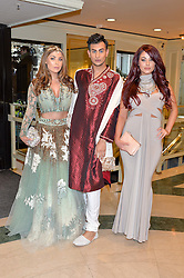 Left to right, ABI CLARKE, JUNAID AHMED and JESSICA HAYES at the 6th annual Asian Awards held at The Grosvenor House Hotel, Park Lane, London on 8th April 2016.