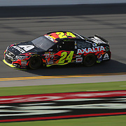 Sprint Cup Series driver Jeff Gordon (24) races during the 57th Annual NASCAR Coke Zero 400 practice session at Daytona International Speedway on Friday, July 3, 2015 in Daytona Beach, Florida.  (AP Photo/Alex Menendez)