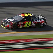 Sprint Cup Series driver Jeff Gordon (24) races during the 57th Annual NASCAR Coke Zero 400 practice session at Daytona International Speedway on Friday, July 3, 2015 in Daytona Beach, Florida.  (AP Photo/Alex Menendez)