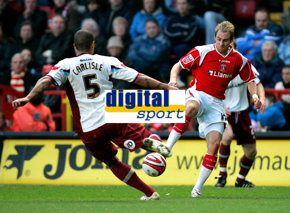 Photo: Tom Dulat/Sportsbeat Images.<br /> <br /> Charlton Athletic v Burnley. Coca Cola Championship. 01/12/2007.<br /> <br /> Clarke Carlisle of Burnley and Luke Varney of Charlton Athletic with the ball.