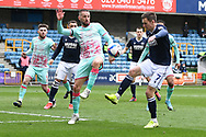 Swansea City Midfielder Conor Hourihane(14) and Millwall midfielder Jed Wallace(7)  battles for possession during the EFL Sky Bet Championship match between Millwall and Swansea City at The Den, London, England on 10 April 2021.