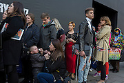 "A child cries while queueing outisde London Fashion Week in the Strand, on 17th Febriary 2017, in London, England, United Kingdom. London Fashion Week is a clothing trade show held in London twice each year, in February and September. It is one of the ""Big Four"" fashion weeks, along with the New York, Milan and Paris. The fashion sector plays a significant role in the UK economy with London Fashion Week alone estimated to rake in £269 million each season. The six-day industry event allows designers to show their collections to buyers, journalists and celebrities and also maintains the city's status as a top fashion capital. (Photo by Richard Baker / In Pictures via Getty Images)"
