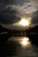View of the Millennium bridge over The River Liffey in Dublin city centre Ireland at sunset