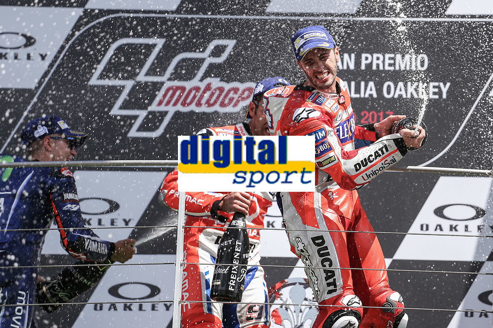 Ducati's Team rider Italian Andrea Dovizioso, winner  the Moto GP Grand Prix at the Mugello race track on June 4, 2017 celebrates on the podium. MotoGP Italy Grand Prix 2017 at Autodromo del Mugello, Florence, Italy on 4th June 2017. <br /> Photo by Danilo D'Auria.<br /> <br /> Danilo D'Auria/UK Sports Pics Ltd/Alterphotos