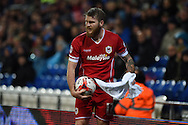 Aron Gunnarsson of Cardiff city prepares to take a long throw-in.  .Skybet football league championship match, Cardiff city v Ipswich Town at the Cardiff city stadium in Cardiff, South Wales on Tuesday 21st October 2014<br /> pic by Andrew Orchard, Andrew Orchard sports photography.