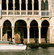 Tourists visit Ca' d'Oro (Golden House), the Palazzo Santa Sofia on the Grand Canal in Venice, Italy