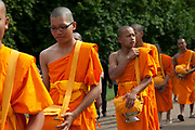 Young Tibetan Buddhist monks walk through Green Park towards the tube. The special dress of ordained people, the robes, comes from the idea of wearing cheap clothes just to protect the body from weather and climate. Monks often make their own robes from cloth that is donated to them. They shall not be made from one piece of cloth, but mended together from several pieces. Since dark red was the cheapest colour in Kashmir, the Tibetan tradition has red robes. In the south, yellow played the same role, though the color of saffron also had cultural associations in India; in East Asia, robe color varies from yellow to brown (Thailand, Theravada), red to purple (Burma, Theravada) and grey or black (e.g., Vietnam, Vajrayana (Zen).