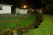 A backyard stream in rural Unicoi County, Tennessee. Photographed at night using an unusually bright yard light that illuminated the neighborhood.
