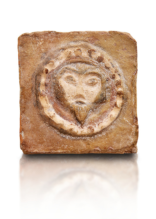 6th-7th Century Eastern Roman Byzantine  Christian Terracotta tiles depicting Christ - Produced in Byzacena -  present day Tunisia. <br /> <br /> These early Christian terracotta tiles were mass produced thanks to moulds. Their quadrangular, square or rectangular shape as well as the standardised sizes in use in the different regions were determined by their architectonic function and were designed to facilitate their assembly according to various combinations to decorate large flat surfaces of walls or ceilings. <br /> <br /> Byzacena stood out for its use of biblical and hagiographic themes and a richer variety of animals, birds and roses. Some deer and lions were obviously inspired from Zeugitana prototypes attesting to the pre-existence of this province's production with respect to that of Byzacena. The rules governing this art are similar to those that applied to late Roman and Christian art with, in the case of Byzacena, an obvious popular connotation. Its distinguishing features are flatness, a predilection for symmetrical compositions, frontal and lateral representations, the absence of tridimensional attitudes and the naivety of some details (large eyes, pointed chins). Mass production enabled this type of decoration to be widely used at little cost and it played a role as ideograms and for teaching catechism through pictures. Painting, now often faded, enhanced motifs in relief or enriched them with additional details to break their repetitive monotony.<br /> <br /> The Bardo National Museum Tunis, Tunisia.  Against a white background.