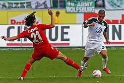 24.04.2010, Volkswagen Arena, Wolfsburg, GER, 1.FBL, VfL Wolfsburg vs 1.FC Koeln, im Bild Pedro Geromel (Koeln #21) versucht Ashkan Dejagah (Wolfsburg #24) zu stoppen .EXPA Pictures © 2011, PhotoCredit: EXPA/ nph/  Schrader       ****** out of GER / SWE / CRO  / BEL ******