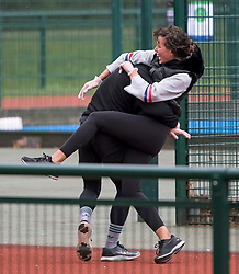© Licensed to London News Pictures. 29/03/2020. London, UK. A man and a woman boxing while exercising, wearing protective gloves, in Paddington Recreation Ground in London, during  lockdown to slow the spread of COVID-19. Members of the public have been told they can only leave their homes to exercise briefly once a day, and to go to shops for essentials when absolutely necessary, in an attempt to fight the spread of COVID-19. Photo credit: Ben Cawthra/LNP
