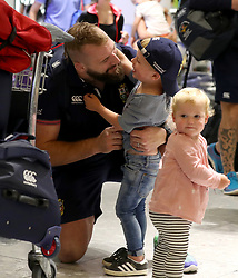 British and Irish Lions Joe Marler greets his children as he arrives at Heathrow Airport as the British and Irish Lions return to the UK following their series draw with New Zealand.