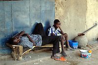 Niger, Agadez, 2007. There is little to do for these two Nigeriens in the center of the big market in Agadez.