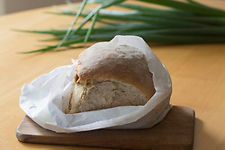 Bread loaf wrapped in paper on the table, Freiburg im breisgau, Baden-wuerttemberg, Germany
