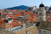 Elevated view of rooftops, Franciscan church bell tower in foreground, Dubrovnik old town, Croatia