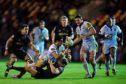 Northampton Winger (#14) Ken Pisi is tackled by Dragons Outside Centre (#13) Pat Leach during the second half of the match - Photo mandatory by-line: Rogan Thomson/JMP - Tel: Mobile: 07966 386802 18/11/2012 - SPORT - RUGBY - Rodney Parade - Newport. Newport Gwent Dragons v Northampton Saints - LV= Cup Round 2