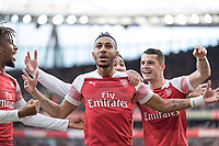 Football - 2018 / 2019 Premier League - Arsenal vs. Tottenham Hotspur<br /> <br /> Pierre-Emerick Aubameyang (Arsenal FC) celebrates in front  of the away fans after scoring at The Emirates.<br /> <br /> COLORSPORT/DANIEL BEARHAM