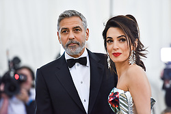 George Clooney and Amal Clooney walking the red carpet at The Metropolitan Museum of Art Costume Institute Benefit celebrating the opening of Heavenly Bodies : Fashion and the Catholic Imagination held at The Metropolitan Museum of Art  in New York, NY, on May 7, 2018. (Photo by Anthony Behar/Sipa USA)