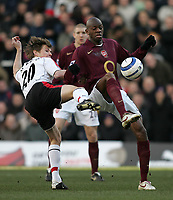 Photo: Lee Earle.<br /> Fulham v Arsenal. The Barclays Premiership. 04/03/2006. Fulham's Brian McBride (L) battles with Abou Diaby.