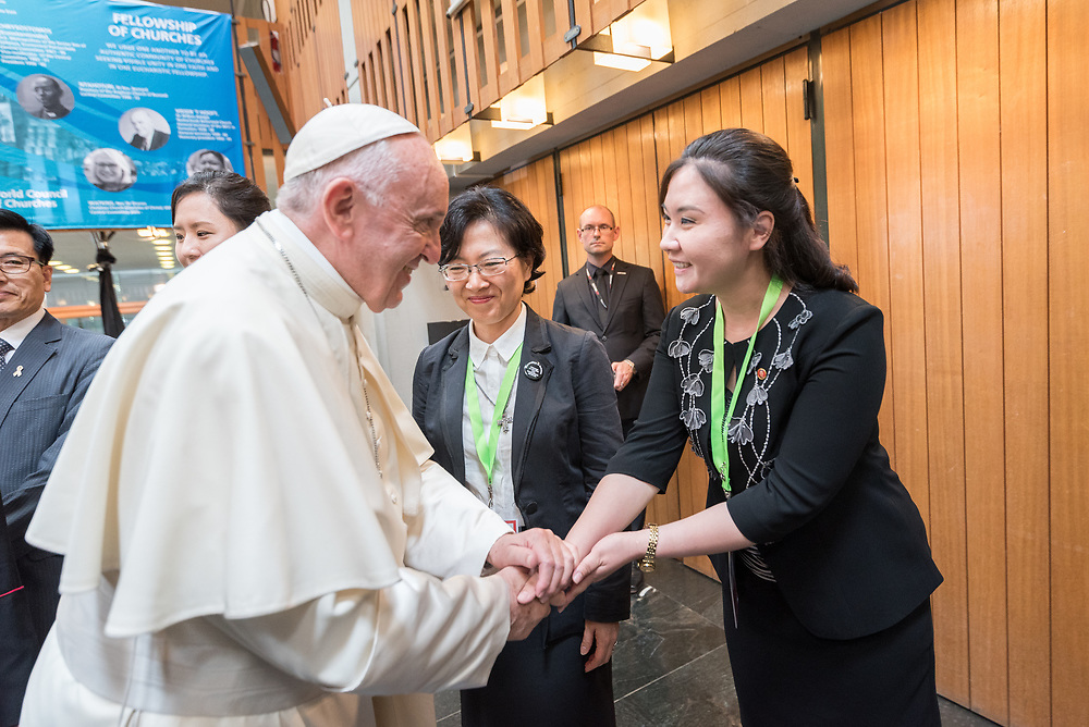 """21 June 2018, Geneva, Switzerland: Preceding an Ecumenical Encounter between Pope Francis and the World Council of Churches, Pope Francis greets a delegation to the WCC from North Korea and South Korea. Here, Ri Kum Gyung from North Korea. On 21 June 2018, the World Council of Churches receives a visit from Pope Francis of the Roman Catholic Church. Held under the theme of """"Ecumenical Pilgrimage - Walking, Praying and Working Together"""", the landmark visit is a centrepiece of the ecumenical commemoration of the WCC's 70th anniversary. The visit is only the third by a pope, and the first time that such an occasion was dedicated to visiting the WCC."""