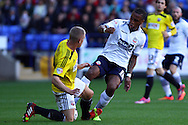 Brentfords' Jake Bidwell  tackles  Bolton Wanderers' Neil Danns. Skybet football league championship match, Bolton Wanderers v Brentford at the Macron stadium in Bolton, Lancs on Saturday 25th October 2014.<br /> pic by Chris Stading, Andrew Orchard sports photography.