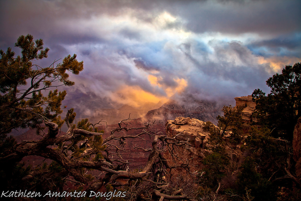 Storm Clouds, Freezing Temperatures, Ice Storms and High Winds rally against a persistant Sunriseat Mather Point, South Rim, Grand Canyon, Arizona.