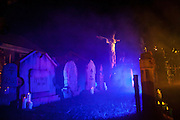"""Fog lifts up over Chris Baker's haunted yard in South Yarmouth, MA. Every year Baker sets up an elaborate Halloween display in his yard and on Halloween, neighborohood residents walk through his frightening """"vortex"""" of horror while trick or treating."""