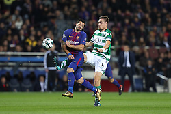 December 5, 2017 - Barcelona, Catalonia, Spain - LUIS SUAREZ of FC Barcelona duels for the ball with SEBASTIAN COATES of Sporting CP during the UEFA Champions League, Group D football match between FC Barcelona and Sporting CP on December 5, 2017 at Camp Nou stadium in Barcelona, Spain. (Credit Image: © Manuel Blondeau via ZUMA Wire)