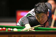 Liang Wenbo (Chn) in action. Ronnie O'Sullivan v Liang Wenbo, 1st round match at the Dafabet Masters Snooker 2017, day 1 at Alexandra Palace in London on Sunday 15th January 2017.<br /> pic by John Patrick Fletcher, Andrew Orchard sports photography.