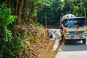 Construction Workers from Myanmar are building new roads through the jungles covering the mountains of the Thai island Koh Phangan, Thailand