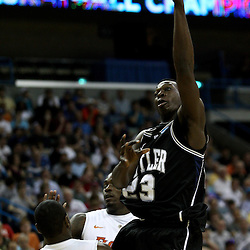 Mar 26, 2011; New Orleans, LA; Butler Bulldogs forward Khyle Marshall (23) shoots over Florida Gators guard Erving Walker (11) during the first half of the semifinals of the southeast regional of the 2011 NCAA men's basketball tournament at New Orleans Arena.   Mandatory Credit: Derick E. Hingle
