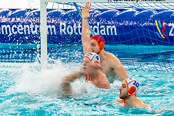 Eelco Wagenaar, Guus Wolswinkel, Pascal Janssen of the Netherlands in action against Enzo Khasz of France during the Olympic qualifying tournament. The Dutch water polo players are on the hunt for a starting ticket for the Olympic Games on February 17, 2021 in Rotterdam