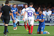 AFC Wimbledon midfielder Liam Trotter (14) with arms out during the EFL Sky Bet League 1 match between AFC Wimbledon and Portsmouth at the Cherry Red Records Stadium, Kingston, England on 13 October 2018.