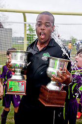 12 April 2015. Hammond, Louisiana.<br /> New Orleans Jesters Champions! <br /> Coach Thando Ngwane following cup presentations and coaches' cold water splash. U9 New Orleans Jesters Elites, team purple defeat U10 PAC Piranhas 5-1 to win their division against U10 teams in the Strawberry Cup hosted by the South Tangipahoa Youth Soccer Association (STYSA).<br /> Photo; Charlie Varley/varleypix.com