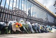 Flowers lay in front of Buckingham Palace as the Union Jack is flown at half mast In memory of Prince Philip The Royal Highness the Duke of Edinburgh, London on 9 April 2021.